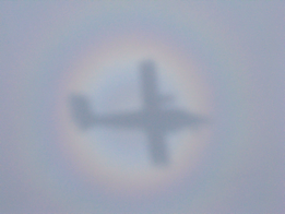 Reflection of plane on cloud with Brocken Spectre © Pintail Media