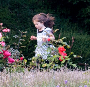 Happily running through garden