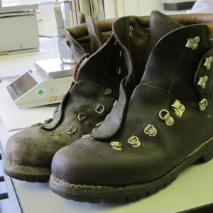 A pair of miners' boots after one has been renovated with Granger product