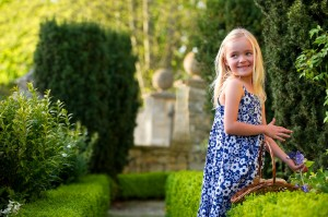 Young villager, Isabella Potter, helping to prepare the garden of the late Sir Hardy Amies